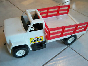 STAKE TRUCK--HEAVY HAULER--TOY-CIRCA 1970-USED