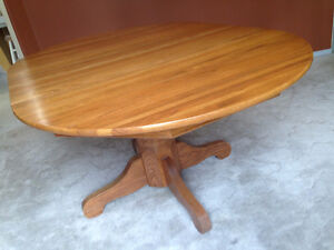 Oval Oak dining room table with 4 chairs