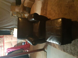 Brown faux leather chair and ottoman
