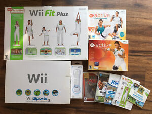 Wii console + WiiFit Plus + EA Active + games + HDMI adapter