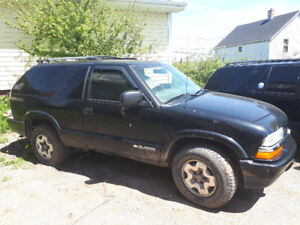 2 Chevi Blazer (pictures within). Looking to trade for good Quad