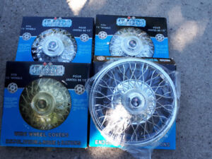 NEW REPLACEMENT WHEEL COVERS $45. SET NEW HUBCAPS.