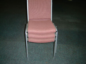 $40 · Padded stacking office chairs next to new