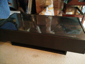 Coffee table with hidden drawers