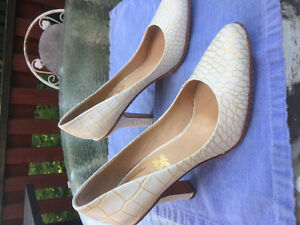 White leather pumps