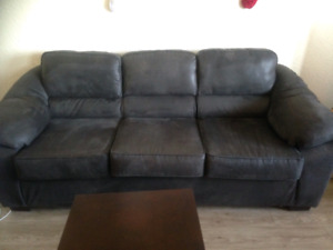 Two piece couch set with two side tables