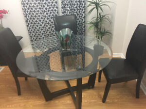New glass dining table with leather chairs