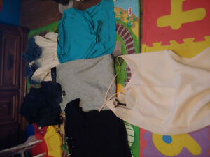 Random lot of women's size small shirts and jacket/vest.