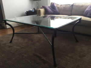 Glass coffee table with cast iron leg base