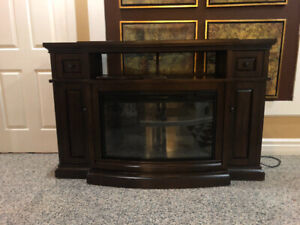 ELECTRIC FIREPLACE AND HEATER WITH STORAGE NEED IT GONE ASAP