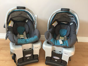 Two Graco SnugRide Classic Connect 30 Infant carseats and bases