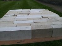NATURAL STONE in sawn block form.
