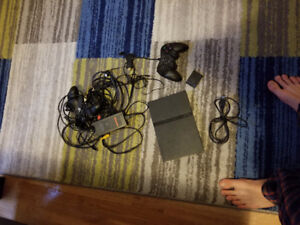PlayStation 2 with 2 controllers and memory card