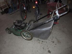 broken gas mower with huge back wheels