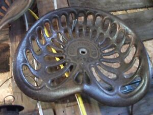 8 CAST IRON TRACTOR SEATS
