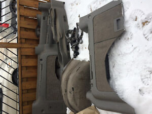 GMC SAFARI INTERIOR PANELS AND BELTS.  NEED GONE MAKE AN OFFER.