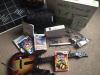 Wii bundle .. Only Wii Guitar and Wii Guitar Hero game left £8