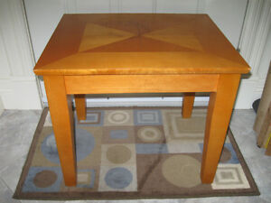.A COMPACT COFFEE TABLE or END TABLE...