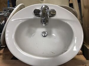 2 bathroom sinks with taps