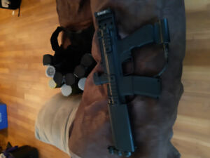 SMG paintball guns and tactical vest