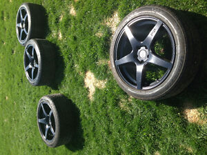 Set of camaro ss rims and tires.