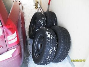 winter rims and tires off a 2006 chrysler 300.