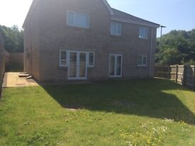Superb 1 double bedroom new build flat with parking , lovely garden only 2 miles from city centre