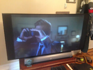 RCA 52 inch LCD flat screen TV with supporting table