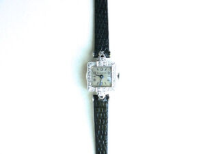 Montre femme antique/vintage-1936 / BULOVA / OR 14K - DIAMANTS