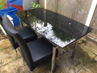 Harveys glass table in black with 6 chairs