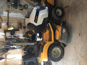 """Cub Cadet GTX2100 comes with 50"""" cutting deck and snow blower."""