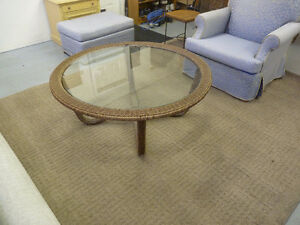 Round glass and wicker table
