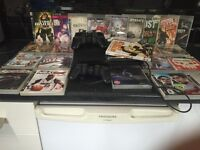 PS3 + 3 Control Pads + 22 Games + 2 Blue Ray Movies
