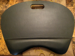 Black Faux leather w/wrist rest and a 2 inches pillow.