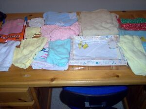 Bin of Baby outfits, blankets (some hand knitted) etc...