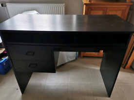 Black IKEA desk with 2 drawers