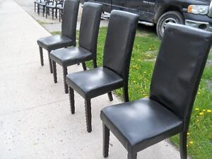 4 Black Polyester covered chairs