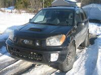 2003 Toyota RAV4 tres propre A-1 8 pneus neuf + 4 shock neufs