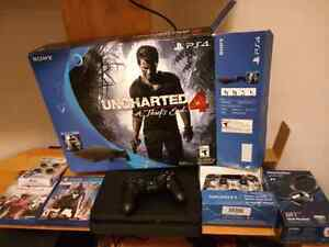 PS4 Slim 500Gb with 2 controllers and 2 games and headset
