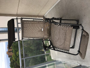 Reclinable lounge chair with foot rest and sun shade