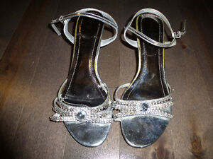 selling a pair of silver jeweled high heel shoes