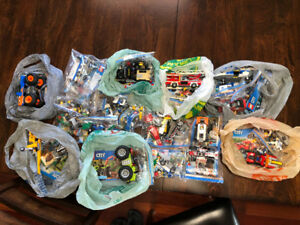 28 LEGO sets (LEGO city and super heroes)! All complete but one