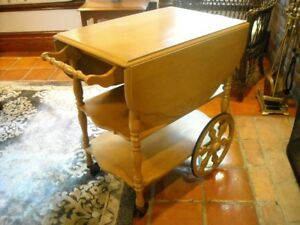 Antique tea wagon with glass bottom serving tray