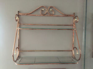Copper wall shelf with brass accents