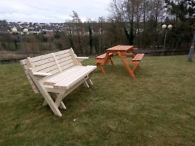 Wooden garden picnic table turns into a bench