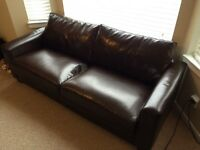 Brown faux leather couch and chair