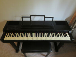 Ensoniq digital piano with stool, not working, in Burnaby