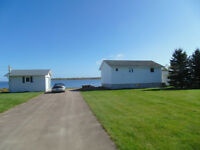 *** WATERRONT Cottage with very large deck, 2 bedroom.***