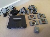 Nintendo 64 with 2 controllers and 4 games and leads for tv