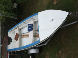 14 ft wood/fiberglass solid boat and trailer